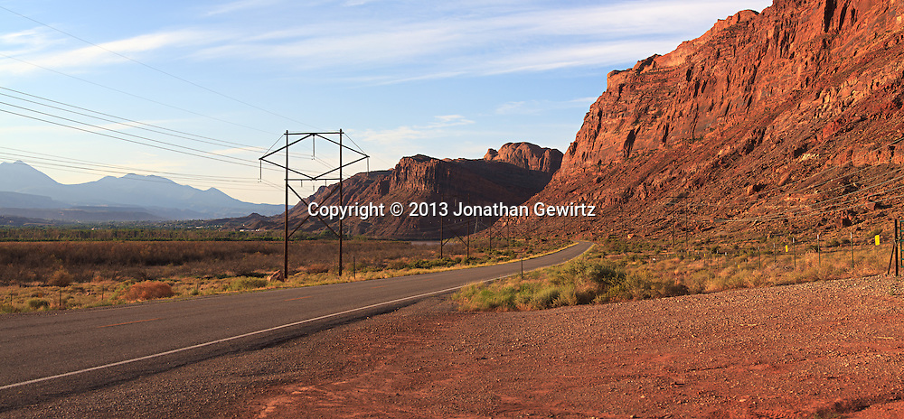 Panoramic view of Utah Route 279/Potash Road at the entrance of the scenic Colorado River gorge in Moab, Utah. The Lasal Mountains are visible in the distant background. WATERMARKS WILL NOT APPEAR ON PRINTS OR LICENSED IMAGES.