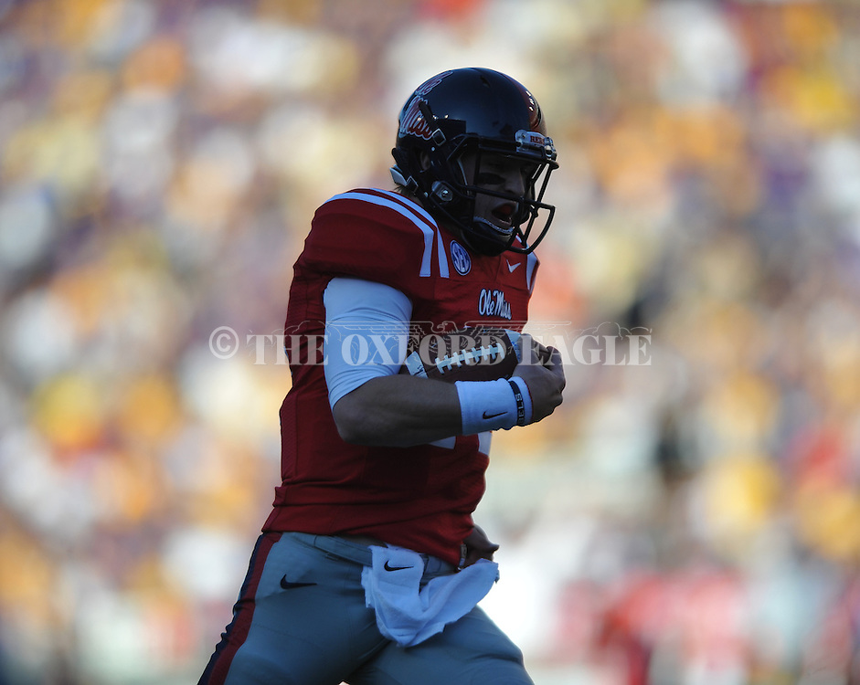 Ole Miss quarterback Bo Wallace (14) scores on a 58 yard run in the  first quarter vs. LSU at Tiger Stadium in Baton Rouge, La. on Saturday, November 17, 2012....