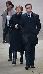 © Licensed to London News Pictures. 21/01/2016. London, UK.  Marina Litvinenko and her son Anatoly arrive at The High Court. The report into the killing of her husband Alexander Litvinenko, who was poisoned with the radioactive isotope polonium-210 in London in 2006, is being released today.  Photo credit: Peter Macdiarmid/LNP