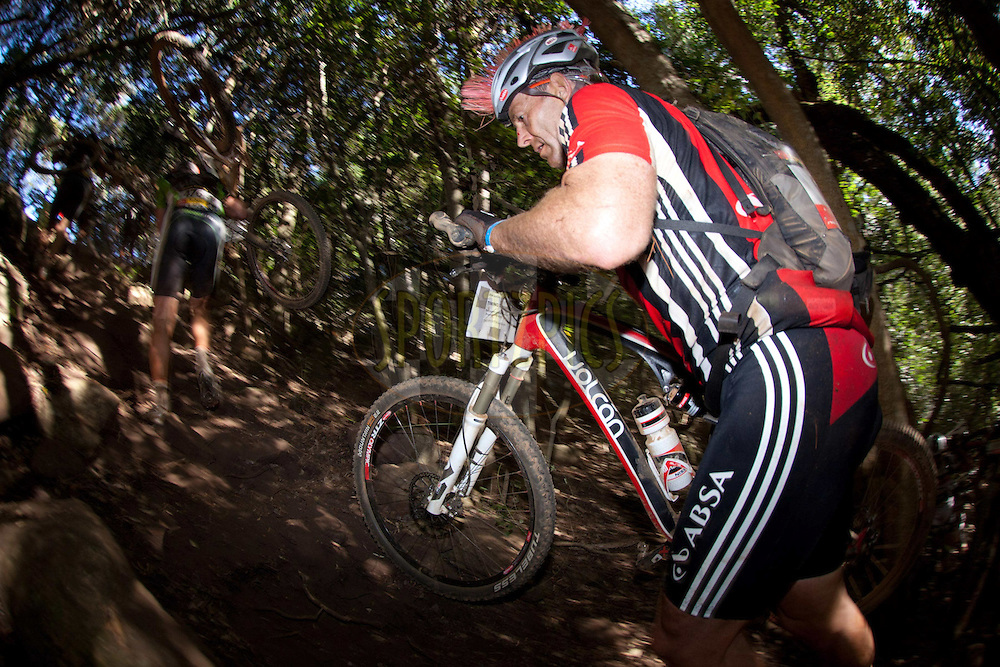 Joel Stransky pushes his bike up the side of a gorge during stage 1 of the 2011 Absa Cape Epic Mountain Bike stage race held from Saronsberg Wine Estate in Tulbagh, South Africa on the 28 March 2011..Photo by Greg Beadle/Cape Epic/SPORTZPICS