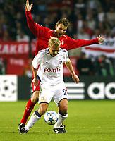Photo: Chris Ratcliffe.<br />Anderlecht v Liverpool. UEFA Champions League.<br />19/10/2005.<br />Dietmar Hamann gets close to Par Zetterburg of Anderlecht