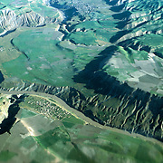 3 June 1976<br /> River cutting deep gorge in folded mountains. Settlement by side of river.