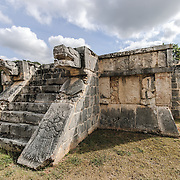 The Venus Platform, with stone jaguar heads on either side of the stairs at Chichen Itza, Mexico