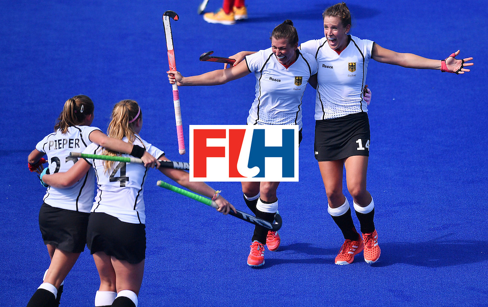 Germany's Janne Muller-Wieland (R) and Germany's Julia Muller (C) celebrate with teammates at the end of the women's quarterfinal field hockey USA vs Germany match of the Rio 2016 Olympics Games at the Olympic Hockey Centre in Rio de Janeiro on August 15, 2016. / AFP / Carl DE SOUZA        (Photo credit should read CARL DE SOUZA/AFP/Getty Images)