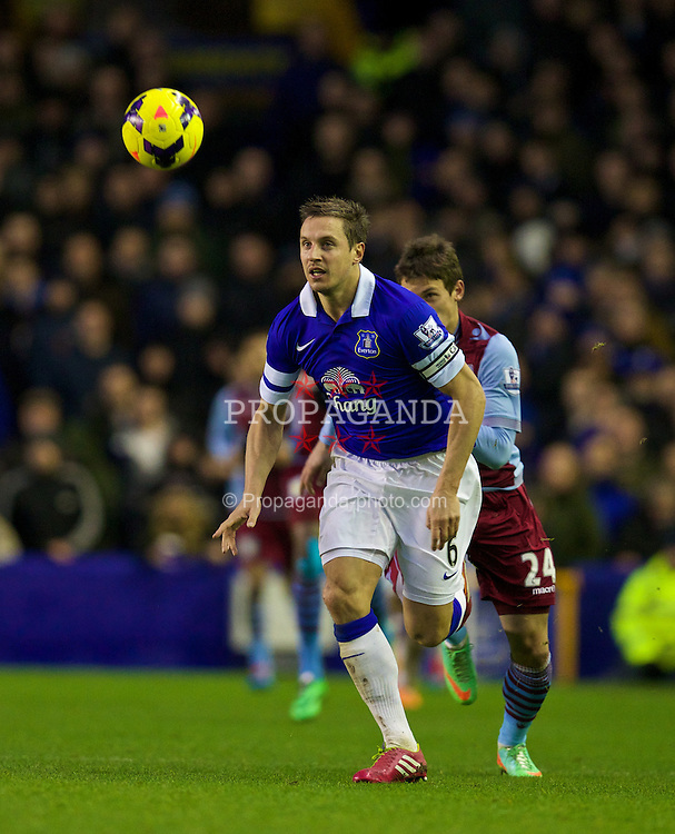 LIVERPOOL, ENGLAND - Saturday, February 1, 2014: Everton's captain Phil Jagielka in action against Aston Villa's Aleksandar Tonev during the Premiership match at Goodison Park. (Pic by David Rawcliffe/Propaganda)