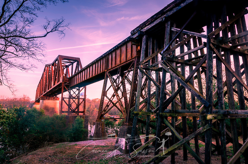 The sun sets on the M&O Railroad trestle March 18, 2014 in Northport, Ala. The wooden and steel truss bridge was build in 1898 for the Mobile and Ohio Railroad. At 135 feet high and 3,600 feet long, it is considered by many to be the country's longest wooden trestle still in use. (Photo by Carmen K. Sisson/Cloudybright)