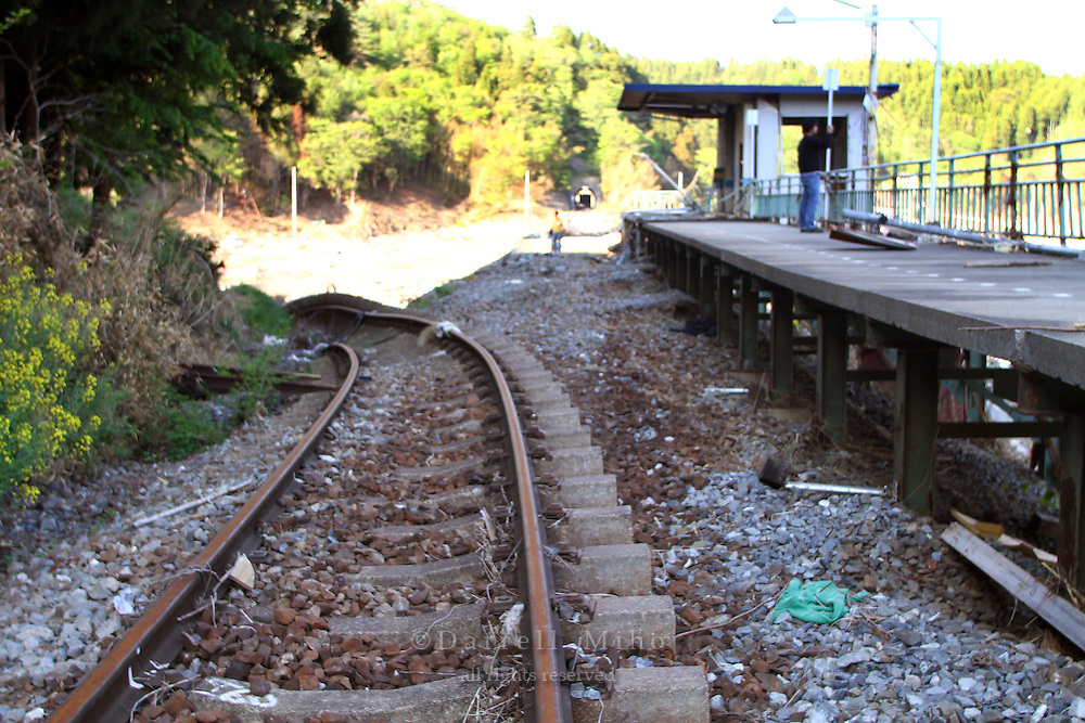 May 18, 2011; Shizuhama, Miyagi Pref., Japan - Damage at Shizuhama Station on the JR Kesennuma Line after the magnitude 9.0 Great East Japan Earthquake and Tsunami that devastated the Tohoku region of Japan on March 11, 2011...The tracks are supposed to go straight towards the tunnel in the distance, but the force of the tsunami pushed the tracks down the hill to the left.