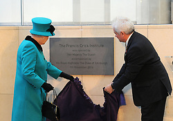 Queen Elizabeth II and Sir Paul Nurse, director of the Francis Crick Institute in central London, unveil a plaque to officially open the institute.