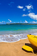 Kayak and paddle on beach on Hanalei Bay, Island of Kauai, Hawaii