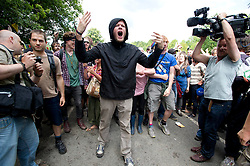 © London News Pictures. 19/08/2013. Balcombe, UK. An Activist shouts at police outside to the Cuadrilla drilling site in Balcombe, West Sussex on a day of of civil disobedience organised by campaign group No Dash For Gas. Cuadrilla has temporarily ceased drilling at the site, which has been earmarked for fracking, under advice from the police. Photo credit: Ben Cawthra/LNP