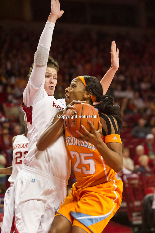Jan 8, 2012; Fayetteville, AR, USA; Tennessee Lady Volunteers  forward Glory Johnson (25) looks to take a shot on Arkansas Razorbacks center Sarah Watkins (4) during a game at Bud Walton Arena. Tennessee defeated Arkansas 69-38. Mandatory Credit: Beth Hall-US PRESSWIRE