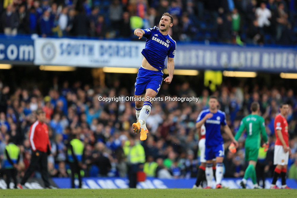 18 April 2015 - Barclays Premier League - Chelsea v Manchester United - Branislav Ivanovic of Chelsea leaps high into the air at full time celebrating the win - Photo: Marc Atkins / Offside.