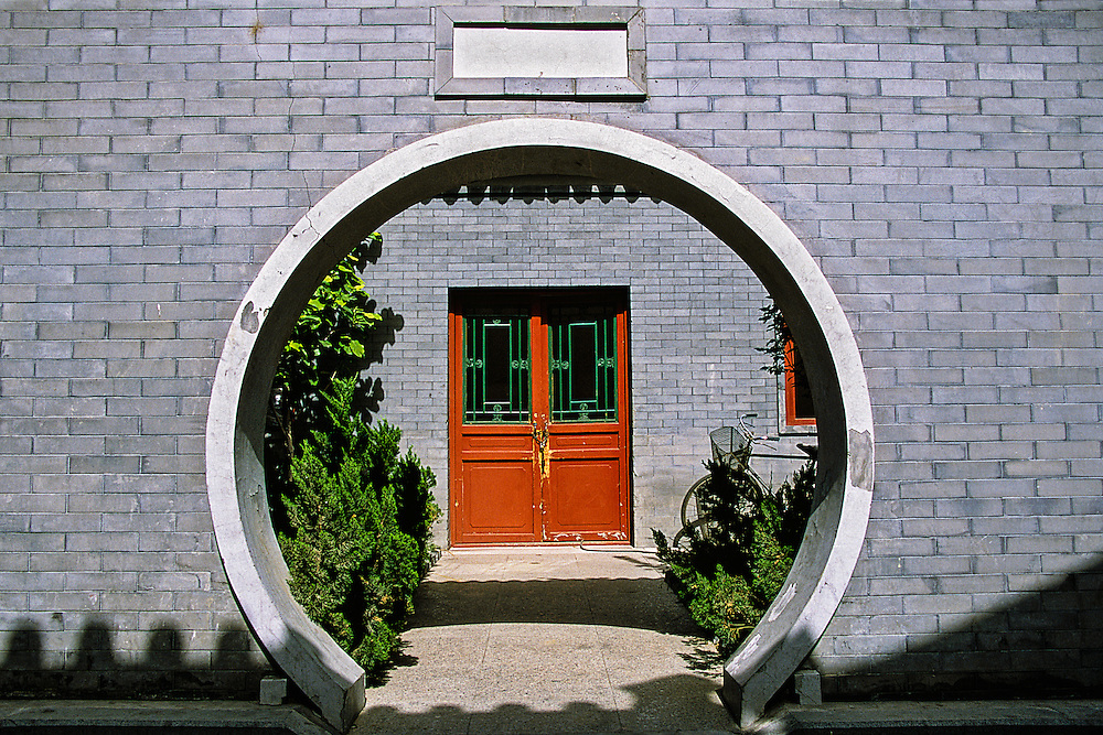The use of contrasting shapes highlights the entryway into a home in Beijing.