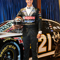 Nascar racer Trevor Bayne poses in a special racing suit and car paint scheme to commemorate Henry Ford's 150th birthday photographed by KMS Photography for Ford Racing.