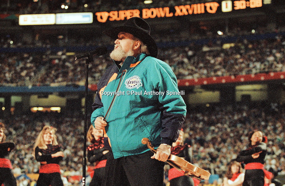 Performer Charlie Daniels plays violin as part of the pregame show before the Dallas Cowboys Super Bowl XXVIII NFL football game against the Buffalo Bills on Jan. 30, 1994 in Atlanta. The Cowboys won the game 30-13. (©Paul Anthony Spinelli)
