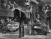 Taking the pulse of a sick Irish emigrant on board ship bound for North America during the potato famine of the 1840s. Wood engraving c1890.