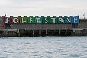 The brightly coloured Folkestone sign on Folkestone Harbour Arm.