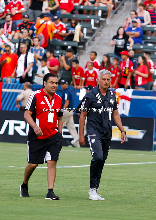 Manchester United head coach Jose Mourinho, right,  in the game against Los Angeles Galaxy during the national friendly soccer game at StubHub Center on July 15, 2017 in Carson, California.   AFP PHOTO / Ringo Chiu