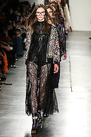 Adela Novotna walks the runway wearing Custo Barcelona Fall 2016 20th Anniversary Collection during New York Fashion Week on February 14, 2016