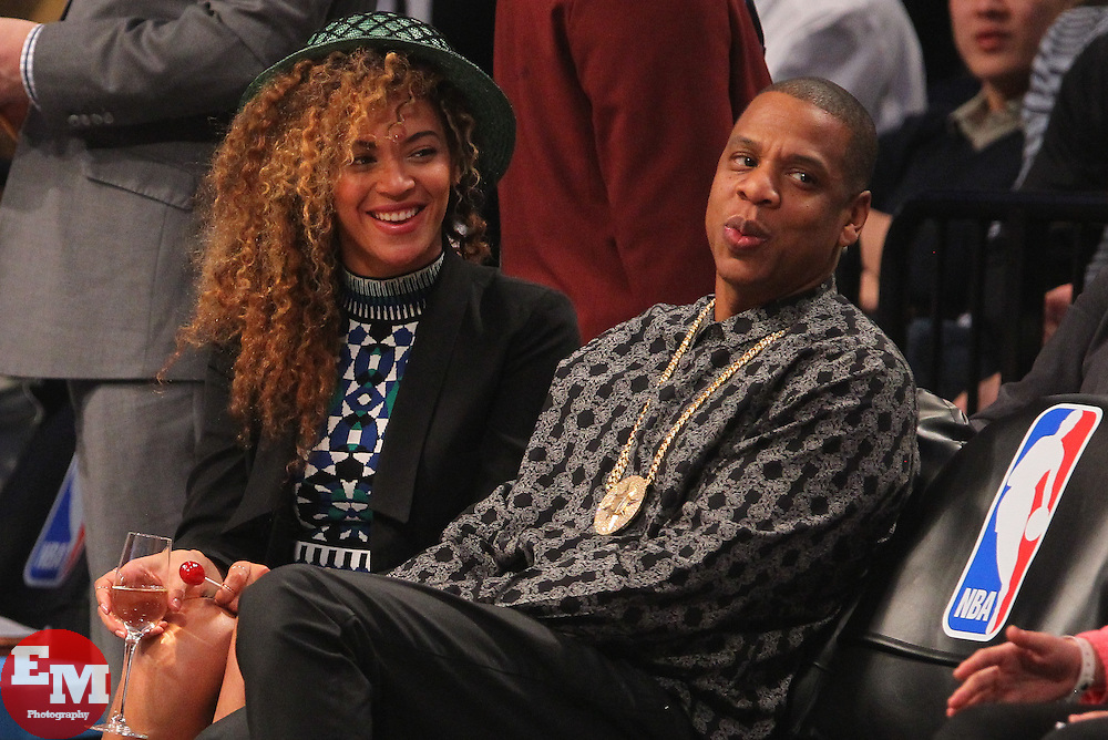 Apr 1, 2014; Brooklyn, NY, USA; Beyonce and Jay-Z watch the game between the Brooklyn Nets and the Houston Rockets during the second quarter at Barclays Center.