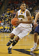 December 29 2010: Iowa Hawkeyes guard/forward Roy Devyn Marble (4) drives with the ball during the first half of an NCAA college basketball game at Carver-Hawkeye Arena in Iowa City, Iowa on December 29, 2010. Illinois defeated Iowa 87-77.