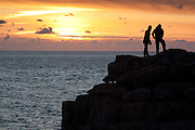 Sun setting into the English Channel from Isle or Purbeck, Dorset, England, UK