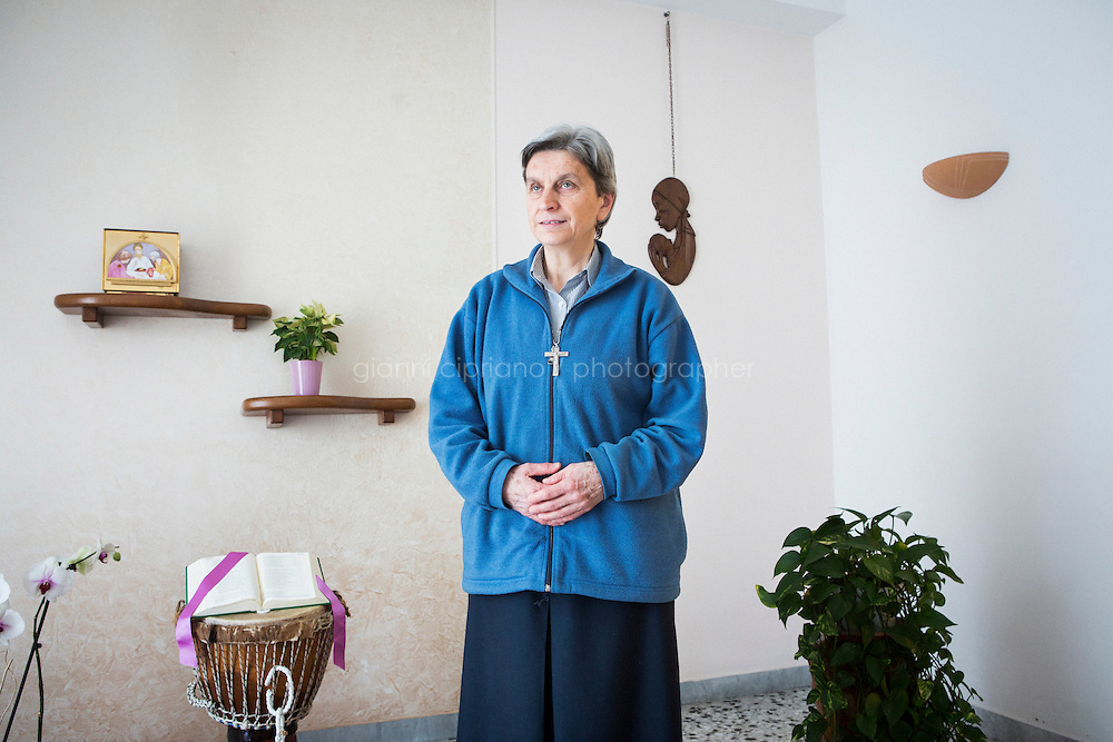 CASERTA, ITALY - 25 FEBRUARY 2015: Sister Rita Giaretta, founder of Casa Rut, poses for a portrait by the makeshift altar at Casa Rut, a shelter for abused young immigrant women in Caserta, Italy, on February 25th 2015.<br /> <br /> Casa Rut was founded in 1995 and it is promoted and managed by the Ursuline Sisters of the Sacred Heart of Mary of Breganze (Vicenza, Italy).  Casa Rut's goal is to provide young immigrant women a familiar environment where  they are helped to protect and free themselves, and to undertake a common path aiming to the integration in Italy's society.