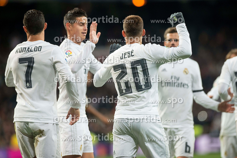 20.03.2016, Estadio Santiago Bernabeu, Madrid, ESP, Primera Division, Real Madrid vs Sevilla FC, 30. Runde, im Bild Real Madrid's Cristiano Ronaldo, James Rodriguez and Jese Rodriguez celebrating a goal // during the Spanish Primera Division 30th round match between Real Madrid and Sevilla FC at the Estadio Santiago Bernabeu in Madrid, Spain on 2016/03/20. EXPA Pictures &copy; 2016, PhotoCredit: EXPA/ Alterphotos/ Borja B.Hojas<br /> <br /> *****ATTENTION - OUT of ESP, SUI*****
