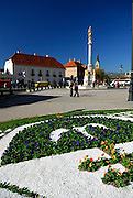 Flower bed in foreground, square with Fountain of the Statue of Holy Mary. Kaptol, Zagreb, Croatia