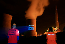 """SPAIN GALICIA AS PONTES 1OCT08 - A Coruña, Spain, 1 October 2008 – Greenpeace activists projected """"Quit Coal,.Save the Climate"""" in Spanish and in English, onto the cooling towers of the As Ponters coal fired power plant in A Coruña, which consumes 20% of Spanish coal and is one of the most polluting power plants in Europe. The protest comes a week before the European Parliament votes on the EU's climate.package, and the construction of over 50 coal plants in Europe...Greenpeace demands the EU votes for measures to block the construction of coal plants, and cut greenhouse gas emissions by at least 30% by 2020. The protest is part of a 4 month """"quit coal"""" ship tour from Israel to Poland, in the run-up to crucial climate negotiations in Poznan, Poland this December...jre/Photo by Jiri Rezac / GREENPEACE..© Jiri Rezac 2008..Contact: +44 (0) 7050 110 417.Mobile:  +44 (0) 7801 337 683.Office:  +44 (0) 20 8968 9635..Email:   jiri@jirirezac.com.Web:    www.jirirezac.com..All images © Jiri Rezac 2008. All rights reserved."""