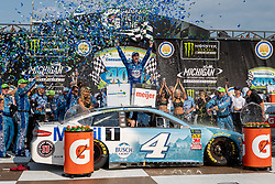 August 12, 2018 - Brooklyn, MI, U.S. - BROOKLYN, MI - AUGUST 12: Monster Energy NASCAR Cup Series driver Kevin Harvick (4) celebrates after winning Monster Energy NASCAR Cup Series Consumers Energy 400 at Michigan International Speedway on August 12, 2018 in Brooklyn, Michigan.(Photo by Adam Lacy/Icon Sportswire) (Credit Image: © Adam Lacy/Icon SMI via ZUMA Press)