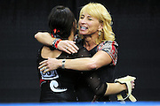 University of Utah junior Stephanie McAllister gets a hug from co-head coach Megan Marsden after McAllister's second vault at the 2011 Women's NCAA Gymnastics Championship Individual Event Finals on April 17, in Cleveland, OH. McAllister tied for 13th place. (photo/Jason Miller)