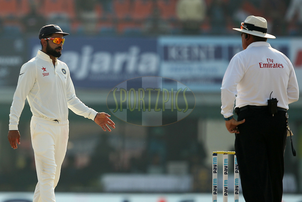 Virat Kohli captain of India talks to umpire during day 3 of the third test match between India and England held at the Punjab Cricket Association IS Bindra Stadium, Mohali on the 28th November 2016.Photo by: Prashant Bhoot/ BCCI/ SPORTZPICS