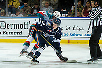 KELOWNA, CANADA - FEBRUARY 2:  Alex Swetlikoff #17 of the Kelowna Rockets checks Connor Zary #18 of the Kamloops Blazers after the face off during first period on February 2, 2019 at Prospera Place in Kelowna, British Columbia, Canada.  (Photo by Marissa Baecker/Shoot the Breeze)