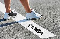 Man standing on finish line
