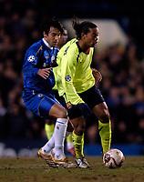 Photo: Richard Lane.<br /> Chelsea v Barcelona. UEFA Champions League. 22/02/2006.<br /> Barcelona's Ronaldinho gets away from Paulo Ferreira.