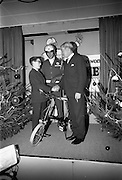 22/12/1965<br /> 12/22/1965<br /> 22 December 1965<br /> <br /> Mr. Sean Flanagan T.D.(Parliamentary Secretary to the Minister for Industry and Commerce presenting a bicycle to Mr. Martin Canfield of Glenageary