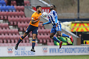 (22) Cheyenne Dunkley for Wigan Athletic and 10 Aaron Holloway for Oldham Athletic during the EFL Sky Bet League 1 match between Wigan Athletic and Oldham Athletic at the DW Stadium, Wigan, England on 30 March 2018. Picture by Graham Holt.