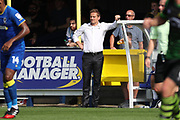 AFC Wimbledon manager Neal Ardley leaning on dug out during the EFL Sky Bet League 1 match between AFC Wimbledon and Doncaster Rovers at the Cherry Red Records Stadium, Kingston, England on 26 August 2017. Photo by Matthew Redman.