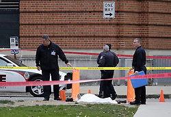 November 28, 2016 - Columbus, Ohio, U.S. - Police cover the body of a suspect along 19th Avenue outside Watts Hall on Ohio State's campus following a vehicular assault and stabbing. An Ohio State University student was shot dead by police after he plowed into pedestrians with a car and then stabbed multiple people with a butcher's knife at the OSU campus in Columbus this morning. (Credit Image: © Adam Cairns/TNS via ZUMA Wire)
