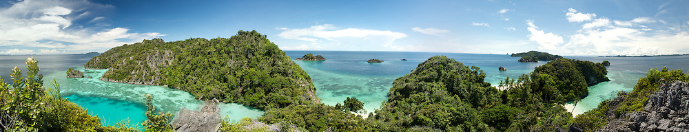 Panoramic view around a beautiful landscape of lagoons, coral reefs, islands, jungle and the endless sea in Misool area, West-Papua.
