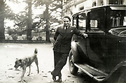 man posing with his automobile France ca 1930s
