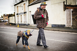 January 14, 2017 - Whittlesey, Cambridgshire, UK - Whittlesey UK. Picture shows a Musician & his dog from the Wakefield Morris dancers arriving at the 38th Whittlesey Straw Bear festival. In times past when starvation bit deep the ploughmen of the area where drawn to towns like Whittlesey, They knocked on doors begging for food & disguised their shame by blackening their faces with soot. In Whittlesey it was the custom on the Tuesday following Plough Monday to dress one of the confraternity of the plough in straw and call him a Straw Bear. The bear was then taken around town to entertain the folk who on the previous day had subscribed to the rustics, a spread of beer, tobacco & beef. The bear was made to dance in front of houses & gifts of money, beer & food was expected. (Credit Image: © Andrew Mccaren/London News Pictures via ZUMA Wire)