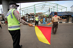 June 24, 2017 - Cirebon, West Java, Indonesia - A number of scouts help the police organizing the traffic at the center of the congestion hub of the Eid al-Fitr holiday festivities at the Gebang Market of Cirebon, West Java, known for years as the culprit of the congestion, resulting from the chaos of market traders who sell on the side of the highway. (Credit Image: © Kuncoro Widyo Rumpoko/Pacific Press via ZUMA Wire)