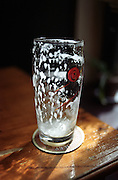 An empty beer glass photographed in a beer pub in Prague Zizkov. Czech beer is known as among the best beers of the world.