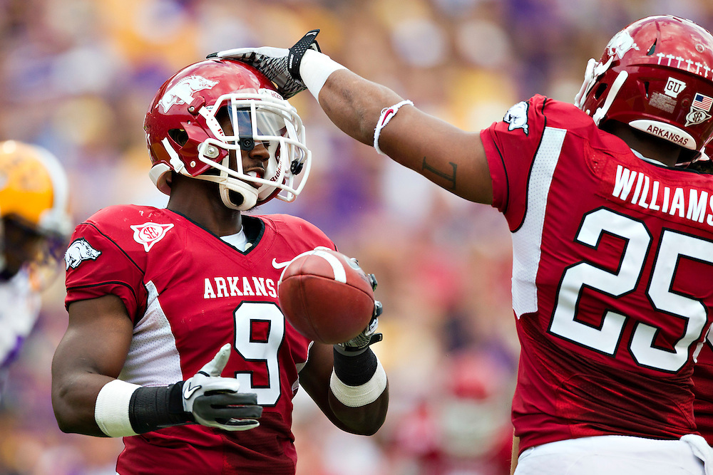 BATON ROUGE, LA - NOVEMBER 25:   Terrell Williams #25 and Elton Ford #9 of the Arkansas Razorbacks celebrate after a big play against the LSU TIgers at Tiger Stadium on November 25, 2011 in Baton Rouge, Louisiana.  The Tigers defeated the Razorbacks 41 to 17.  (Photo by Wesley Hitt/Getty Images) *** Local Caption *** Terrell Williams; Elton Ford