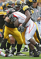 October 03, 2009: Arkansas State running back Reggie Arnold (2) is hit by Iowa defensive tackle Broderick Binns (91) during the second half of the Iowa Hawkeyes' 24-21 win over the Arkansas State Red Wolves at Kinnick Stadium in Iowa City, Iowa on October 03, 2009.