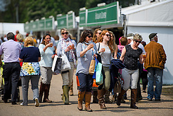 © London News Pictures. 12/05/2016. Windsor, UK. People enjoy the sunshine on the first day of the 2016 Royal Windsor Horse Show, held in the grounds of Windsor Castle in Berkshire, England. The opening day of the event was cancelled due to heavy rain and waterlogged grounds. This years event is part of HRH Queen Elizabeth II's 90th birthday celebrations.  Photo credit: Ben Cawthra/LNP
