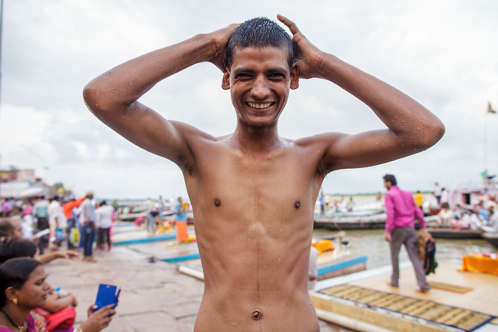 Young pilgrim after bathing at Dashashwamedh Gath by the Ganges River in Varanasi, India.