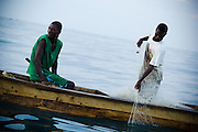 Fishermen pull nets they had left overnight into their small wooden boat a few hundred meters away from shore near Cape Coast, roughly 120km west of Ghana's capital Accra on Thursday April 9, 2009.